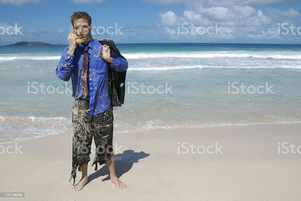 Castaway Businessman Calls on Banana Phone royalty-free stock photo