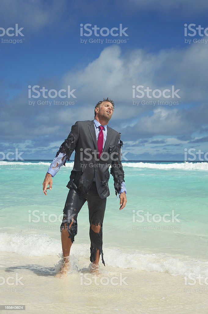 Castaway Businessman Emerges from Tropical Sea stock photo