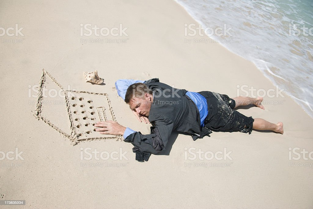 Castaway Businessman Falling Asleep at his Computer royalty-free stock photo