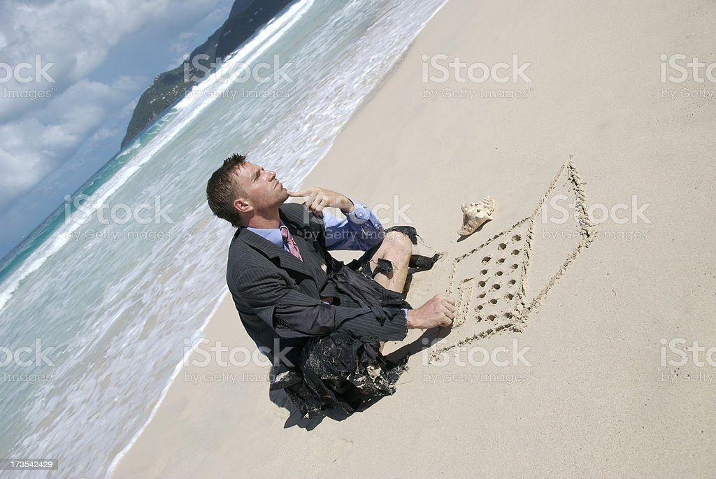 Castaway Businessman Looks Thoughtful Working on Sand Laptop stock photo