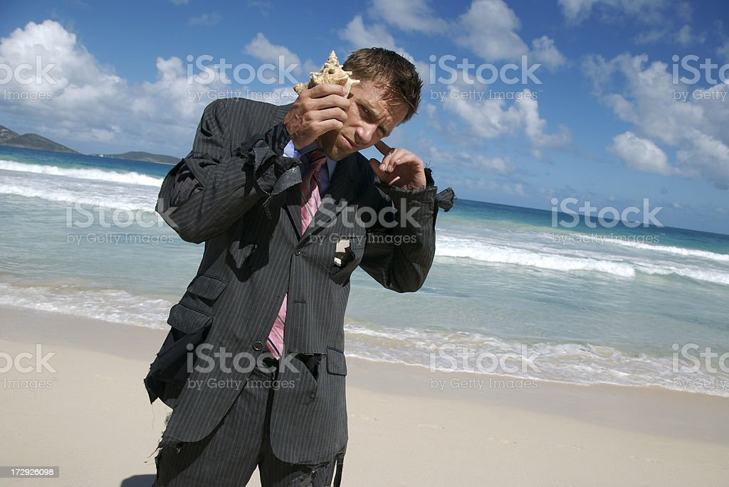 Castaway Businessman Makes Call on His Shellphone royalty-free stock photo