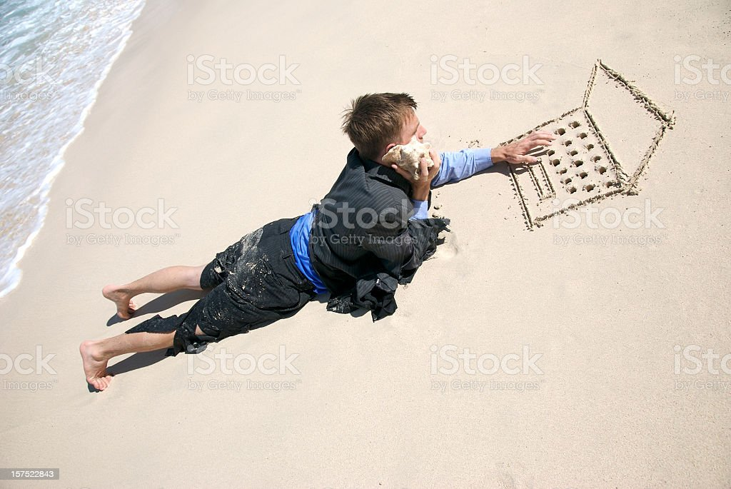 Castaway Businessman Multitasking Working on Beach stock photo