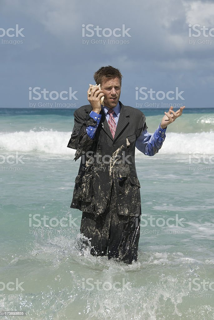 Castaway Businessman on Shell Phone royalty-free stock photo