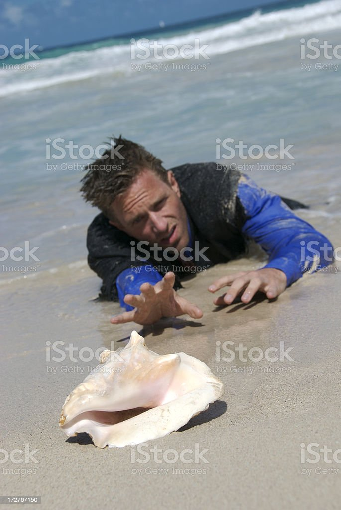 Castaway Businessman Reaches for his Shell Phone royalty-free stock photo