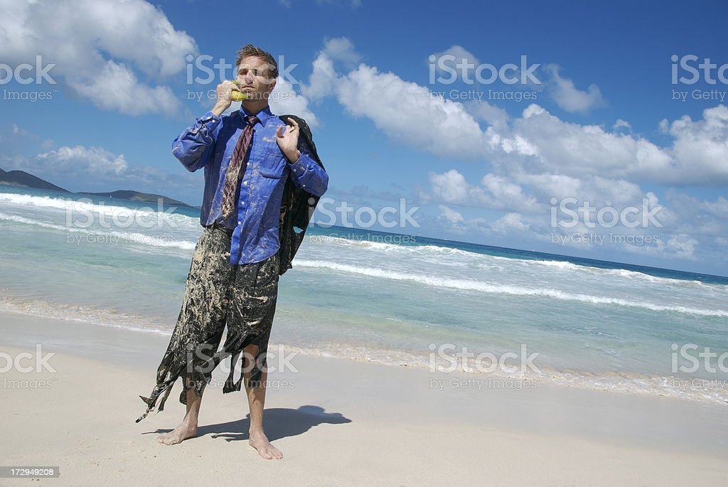 Castaway Businessman Shredded Suit Talking on Banana Phone royalty-free stock photo