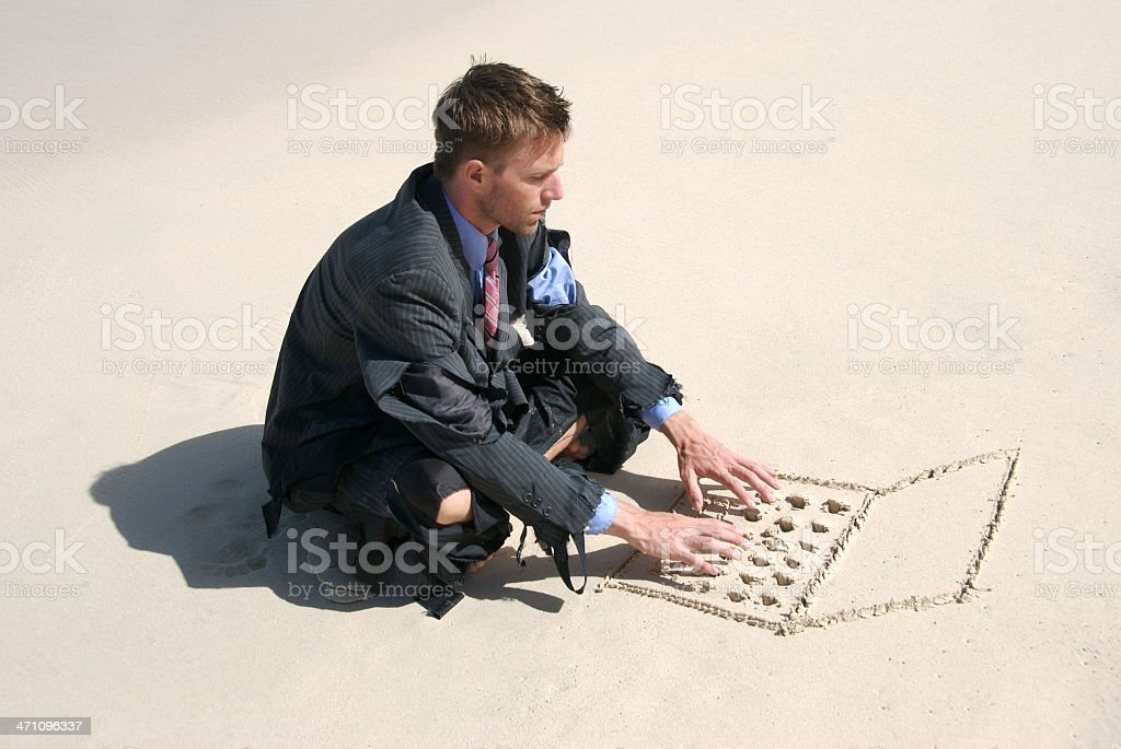 Castaway Businessman Sits Typing on Sand Computer royalty-free stock photo