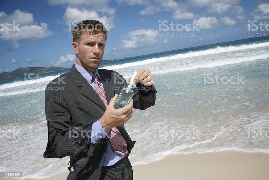 Castaway Businessman w Message in a Bottle royalty-free stock photo