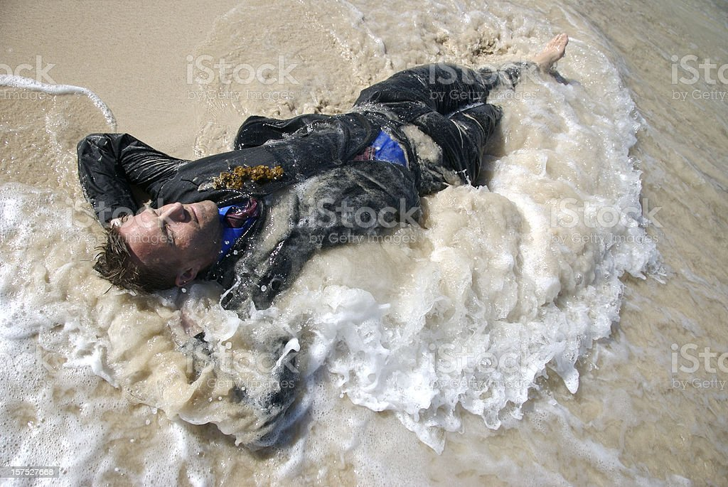 Castaway Businessman Washed Up in Sandy Wave royalty-free stock photo