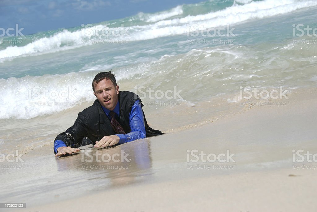 Castaway Businessman Washes Ashore stock photo