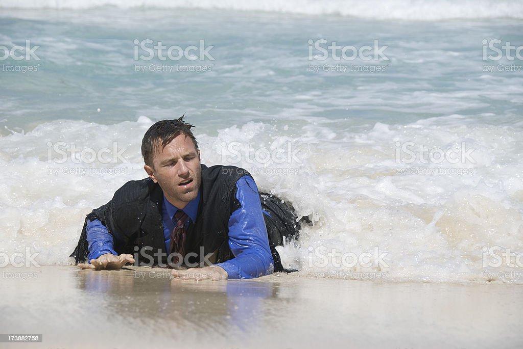 Castaway Businessman Washes Ashore royalty-free stock photo