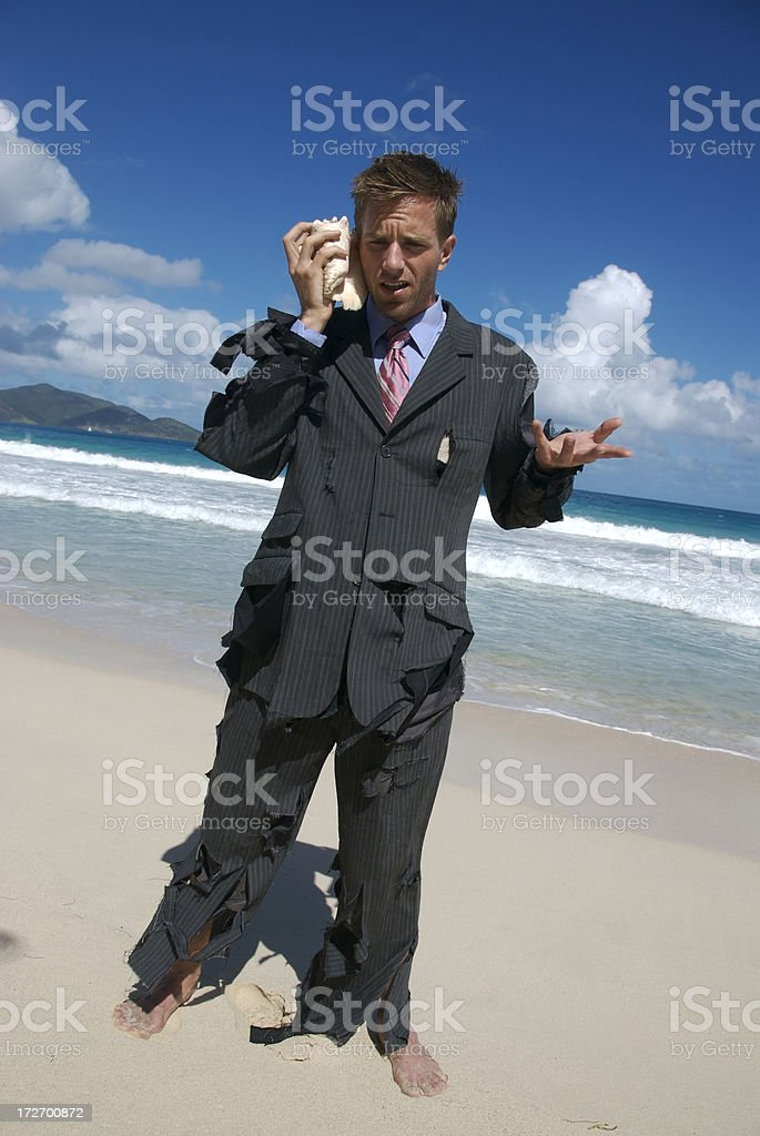 Castaway Businessman Yells Into his Shell Phone royalty-free stock photo