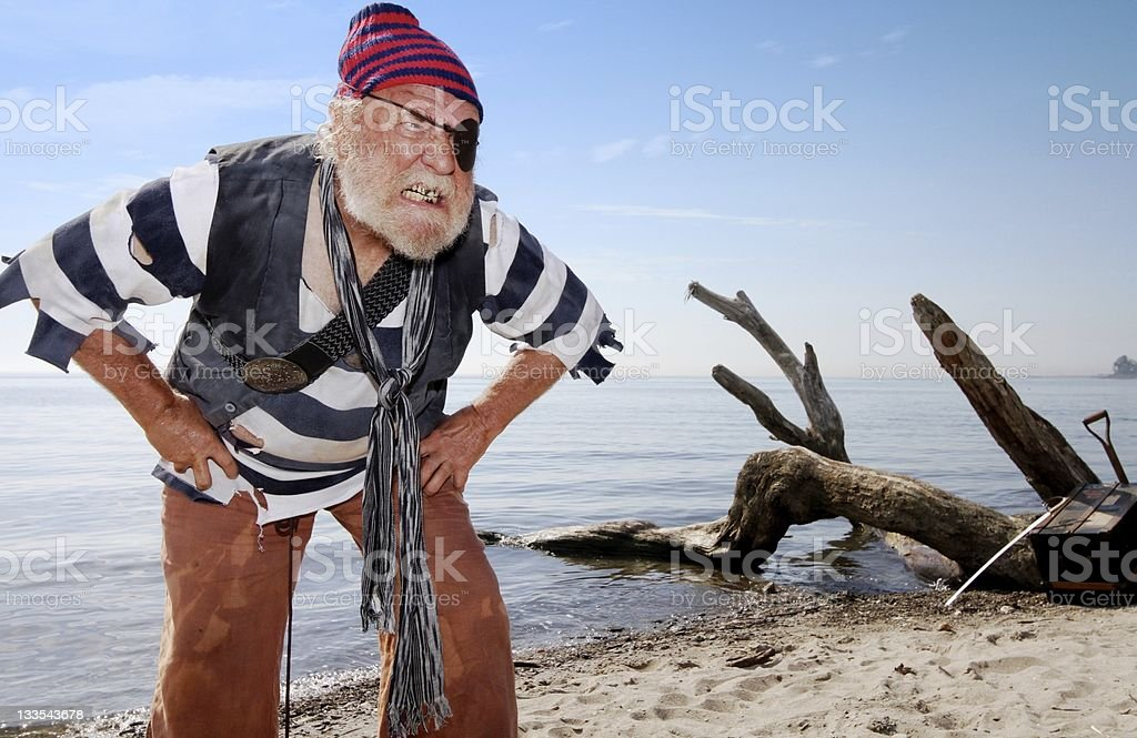 Castaway pirate defends treasure chest royalty-free stock photo