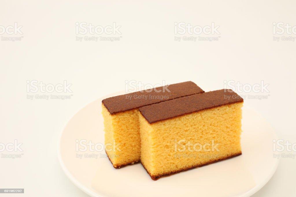 castella japanese sponge cake on plate on white background stock photo