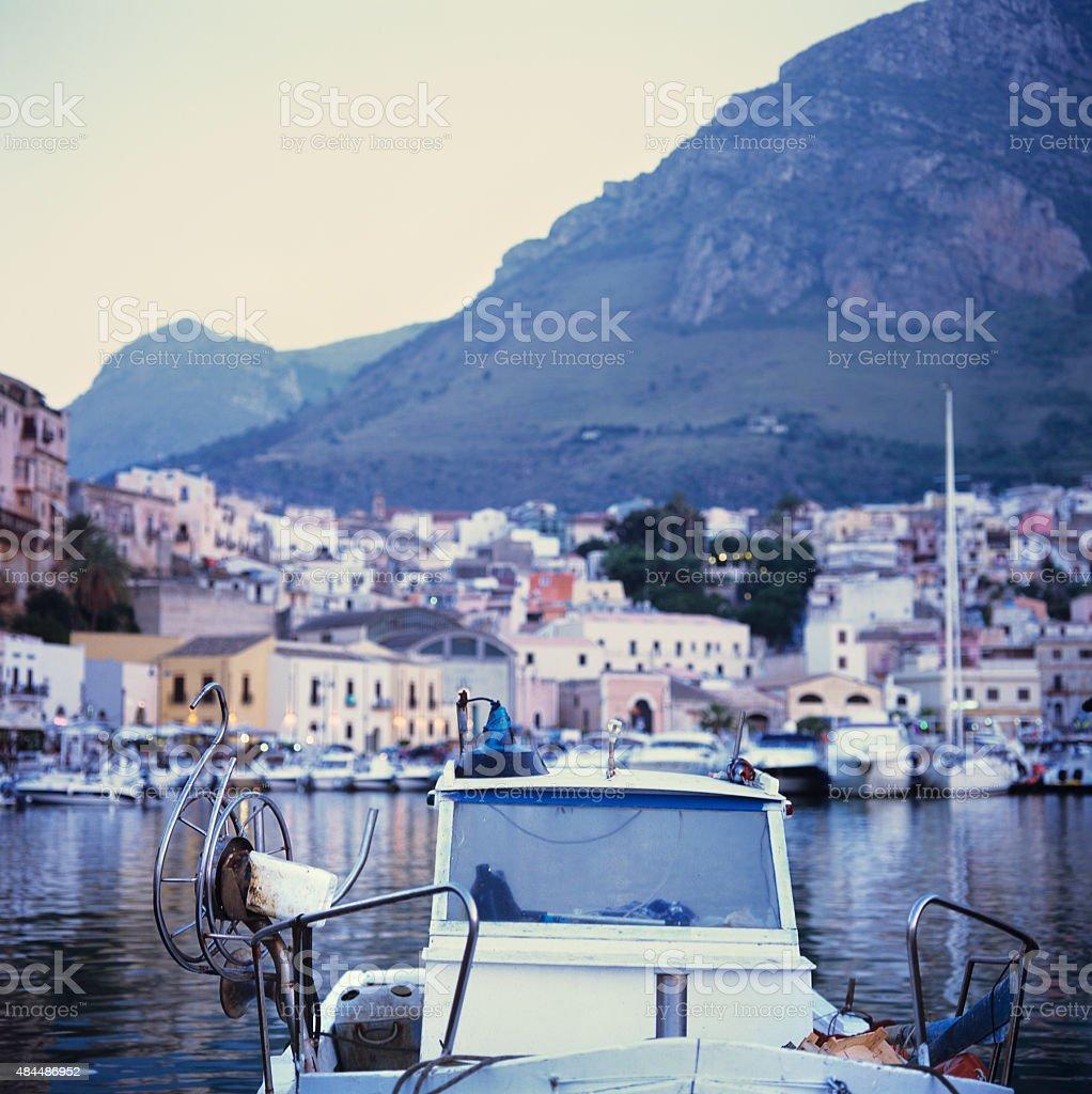 Castellammare del Golfo, harbour, fishing boat and village stock photo
