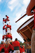 Castellers and Man Playing Drum on Sunny Day