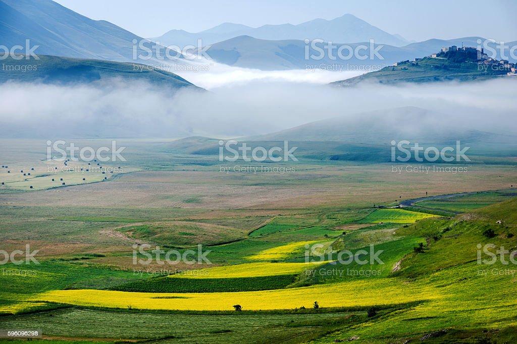 Castelluccio di Norcia (Italy), Village on a green hill,morning stock photo