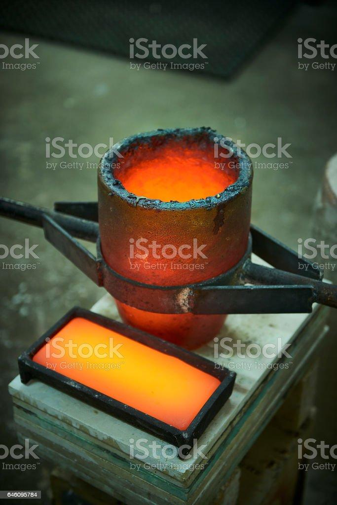 Casting a bronze alloy bar stock photo