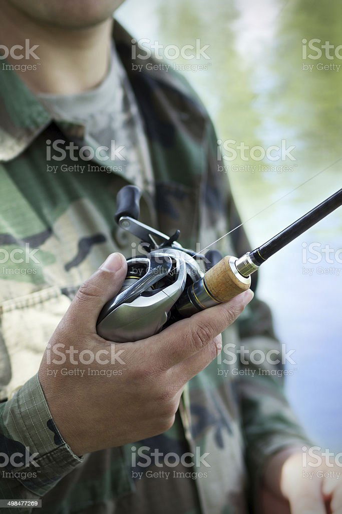 Casting a fishing reel royalty-free stock photo