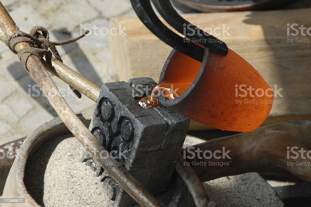 casting metal like in the bronze age stock photo