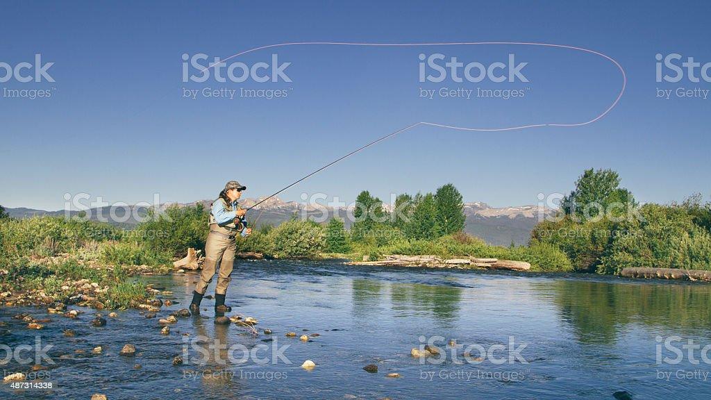 Casting the fishing rod stock photo