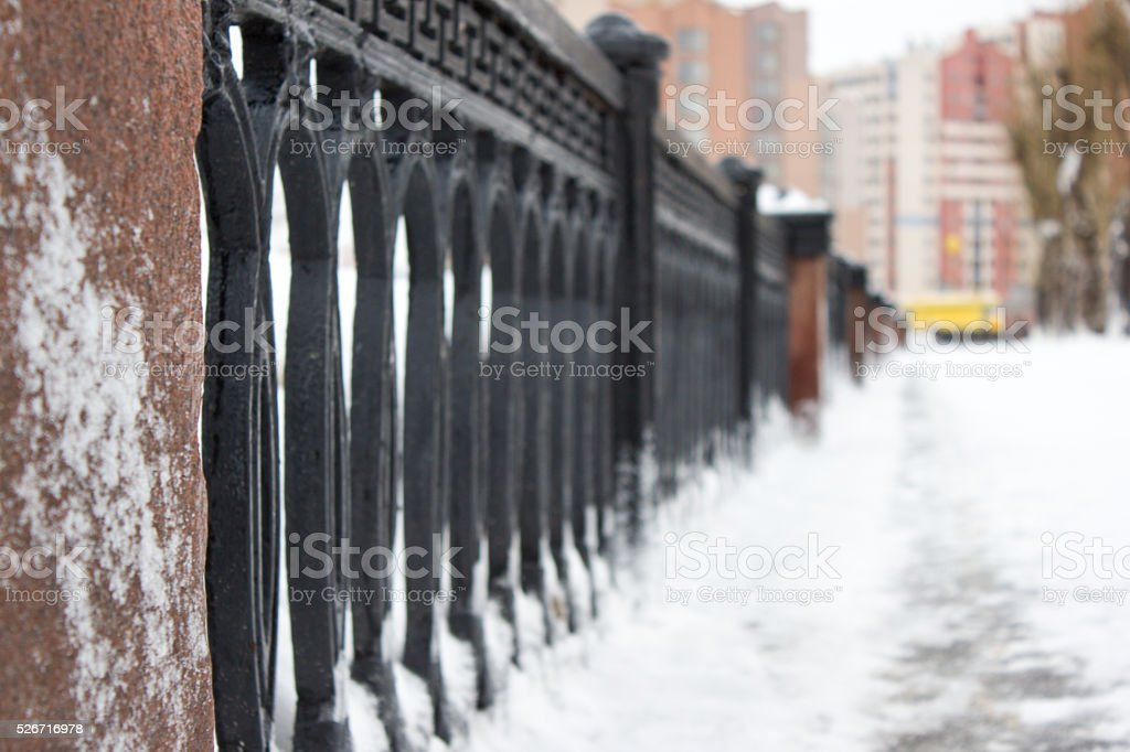 Cast-iron fence in frost stock photo