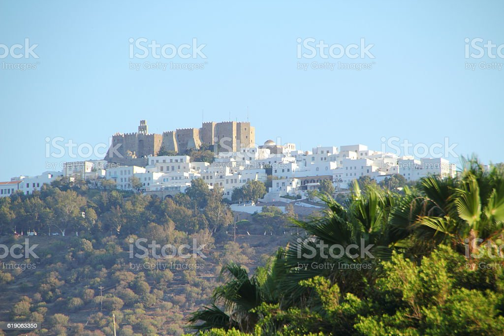 castle and white houses in patmos stock photo