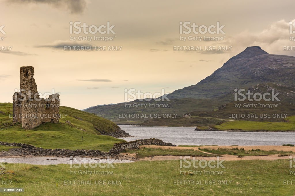 Castle Ardvreck at Loch Assynt with mountain, Scotland. stock photo