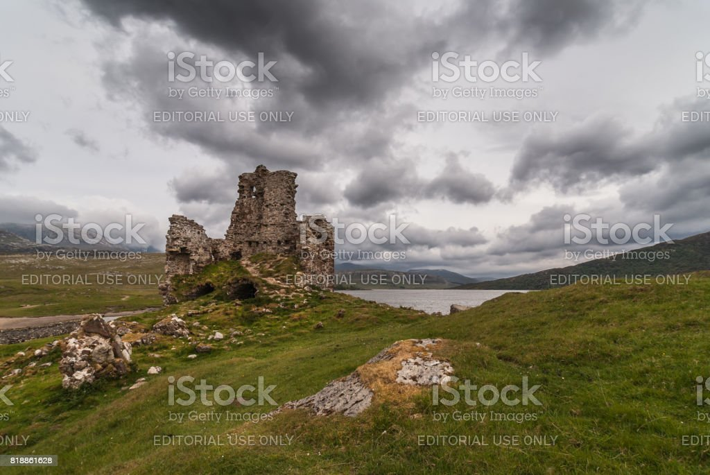 Castle Ardvreck ruins under storm sky, Scotland. stock photo