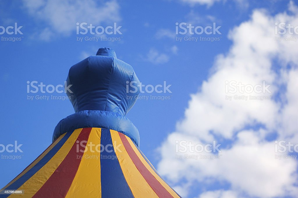 castle bounce house with clouds and blue sky stock photo