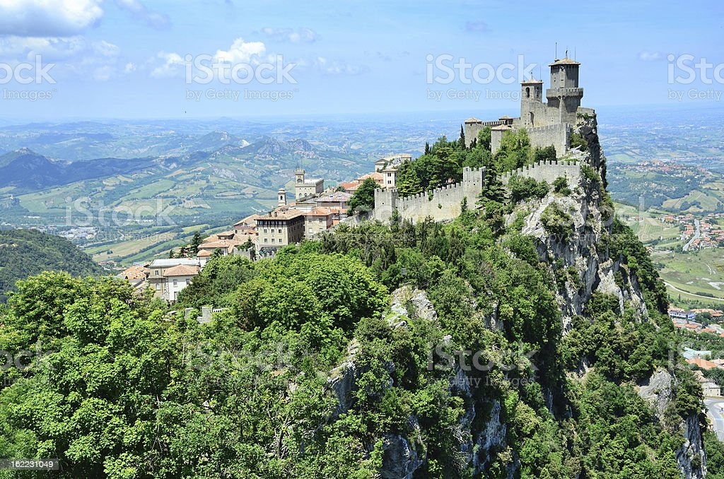 A castle covered in greenery in San Marino stock photo