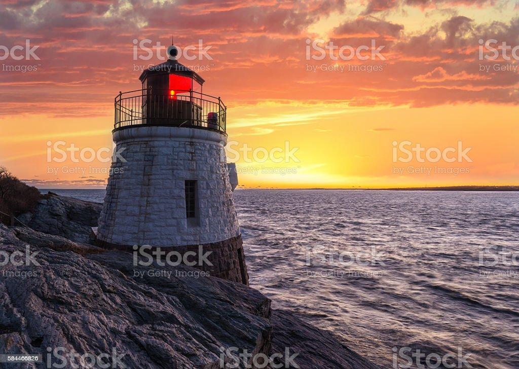 Castle Hill Lighthouse in orange sunset stock photo