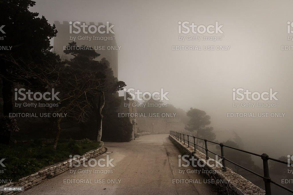 Castle in fog. Erice, Sicily, Italy stock photo