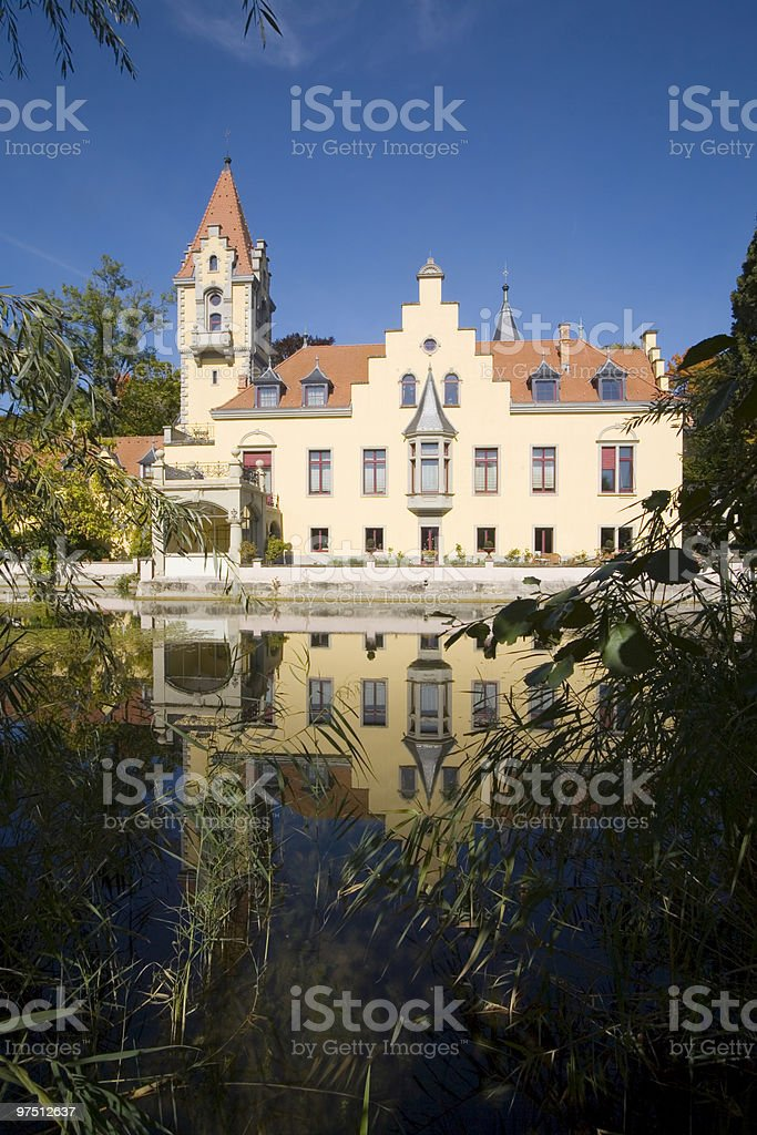 Castle mirroring in the water. stock photo