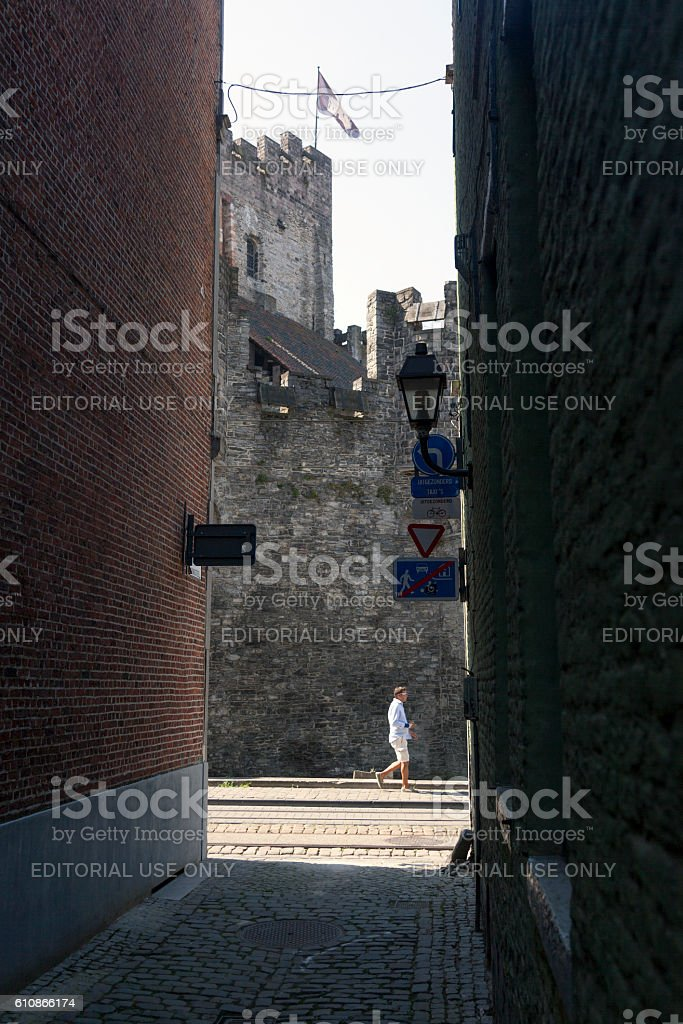castle of gravensteen in Ghent seen from narrow old alley stock photo