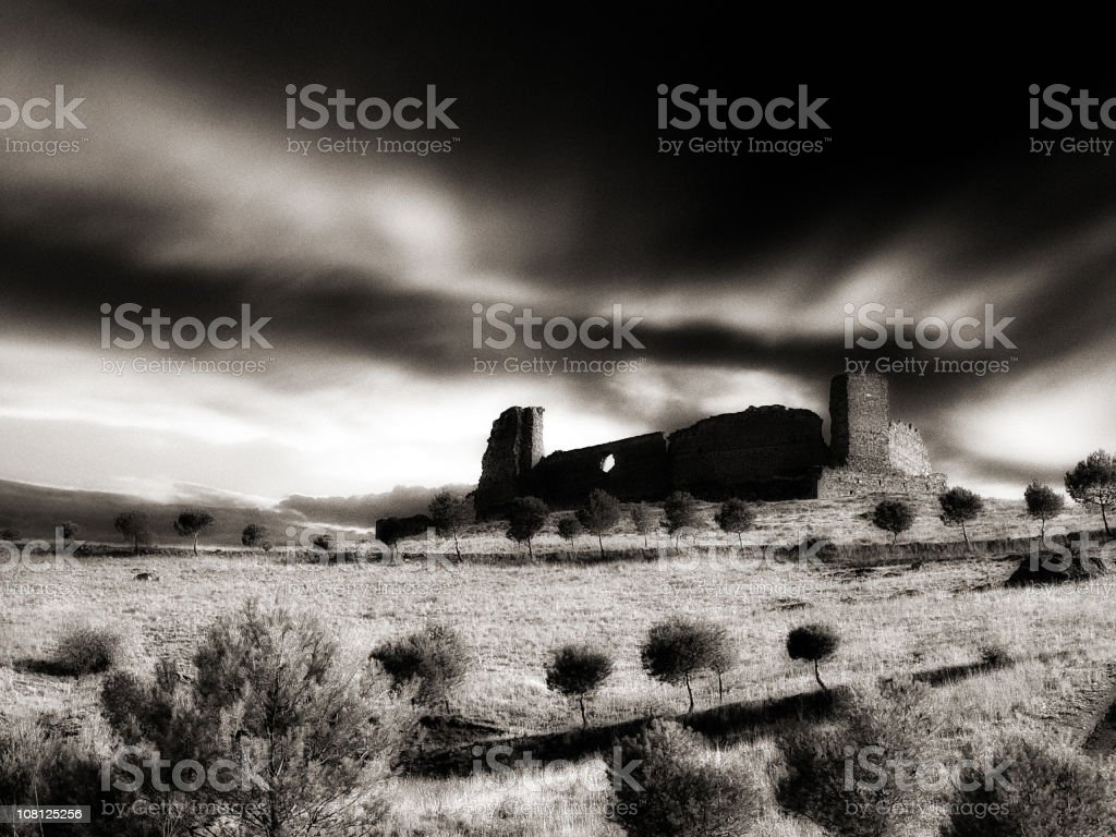 Castle Ruins in Field, Low Key Black and White royalty-free stock photo