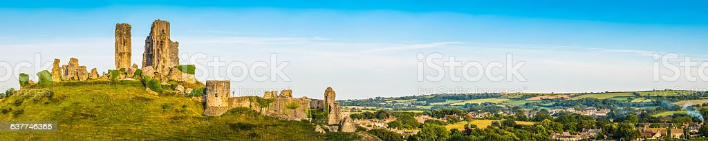 Castle ruins on hilltop overlooking village Corfe Castle Dorset panorama stock photo