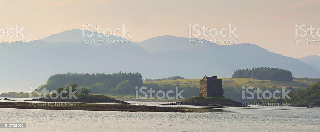 Castle Stalker at sunset stock photo