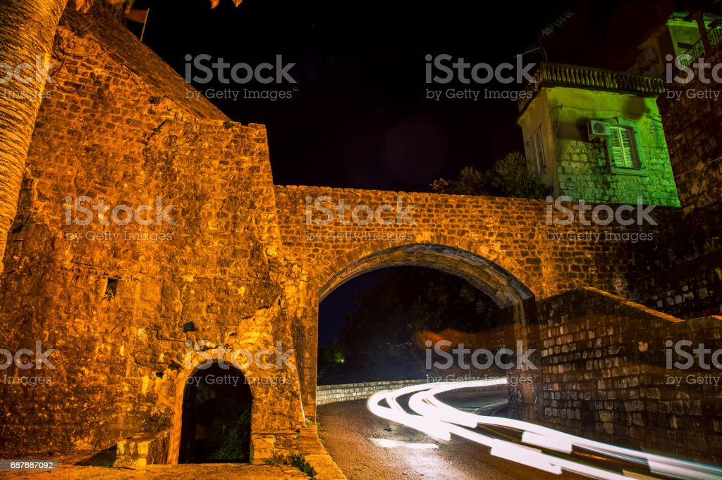 castle wall at night herceg novi stock photo