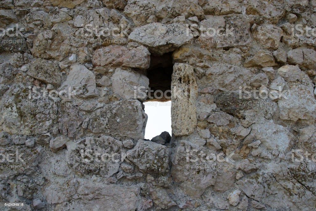 castle window in stone wall stock photo