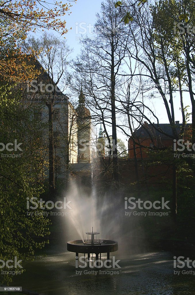 Castle with fontaine royalty-free stock photo