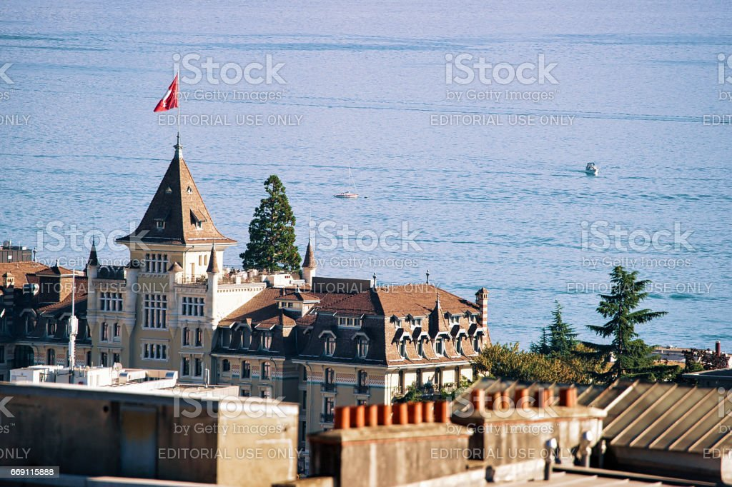 Castle with tower seen from Esplanade de Montbenon in Lausanne stock photo