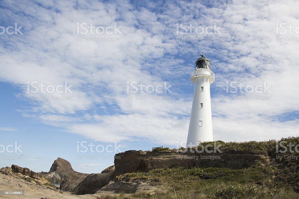 Castlepoint Lighthouse On Rocks stock photo