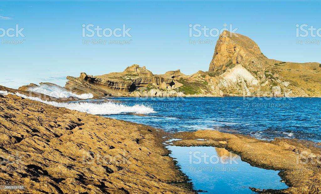 Castlepoint Rock Cross stock photo