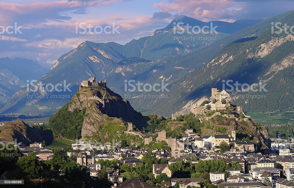Castles Valere and Tourbillon, Sion, Switzerland in the evening light stock photo