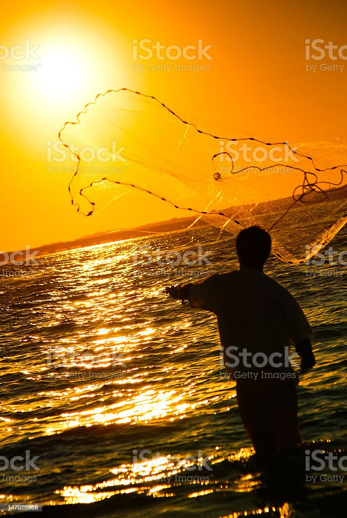 Cast-net Fishing at Sunset royalty-free stock photo