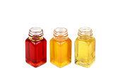 Castor oil, rosehip oil and mustard oil on white background