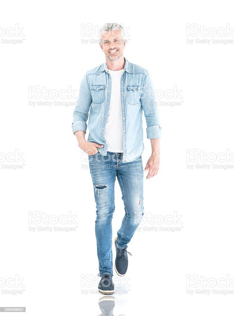 Casual adult man walking stock photo