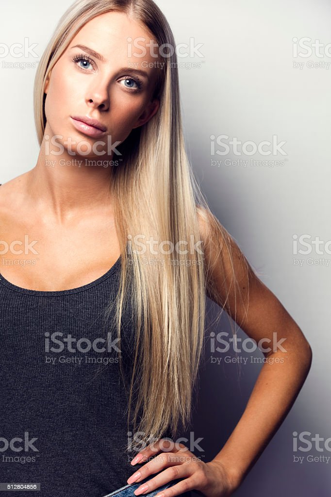 Casual and confident blonde woman model stock photo