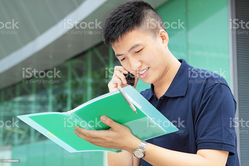 Casual asian businessman on the phone royalty-free stock photo