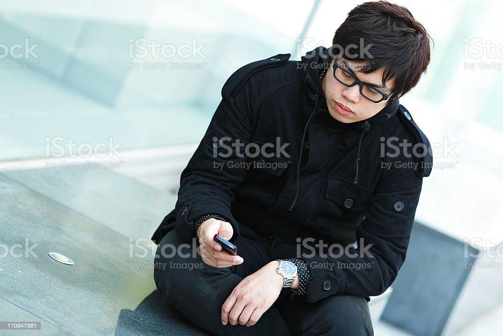 Casual asian businessman texting stock photo
